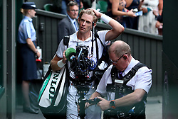 Kevin Anderson walks off court after his 7-6 (8/6) 6-7 (5/7) 6-7 (9/11) 6-4 26-24 win in the longest semi-final in the tournament's history on day eleven of the Wimbledon Championships at the All England Lawn Tennis and Croquet Club, Wimbledon.