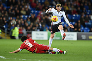 Rotherham's Paul Green is tackled by Cardiff's Fabio Da Silva. Skybet football league championship match, Cardiff city v Rotherham Utd at the Cardiff city stadium in Cardiff, South Wales on Saturday 6th December 2014<br /> pic by Andrew Orchard, Andrew Orchard sports photography.