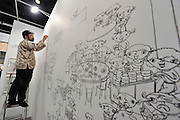 HONG KONG - MARCH 13:  Artist Shintaro Miyake draws a sketch part of his 'Excursions in Asia' series in art fair Art Basel on its preview day on March 13, 2015 in Hong Kong, Hong Kong.  (Photo by Lucas Schifres/Getty Images)