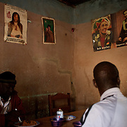 January 19, 2013 - Niono, Mali: Locals take lunch at a restaurant, with Kaddafi, Bob Marley and Emperor Haile Selassiei poster displayed on the wall, in Niono village, the last government controlled location before Diabaly, a city under islamist militants control since the 14th of January. In the back<br /> <br /> Several insurgent groups have been fighting a campaign against the Malian government for independence or greater autonomy for northern Mali, an area known as Azawad. The National Movement for the Liberation of Azawad (MNLA), an organisation fighting to make Azawad an independent homeland for the Tuareg people, had taken control of the region by April 2012.<br /> <br /> The Malian government pledge to the French army to help the national troops to stop the rebellion advance towards the capital Bamako. The french troops started aerial attacks on rebel positions in the centre of the country and deployed several hundred special forces men to counter attack the advance on the ground. (Paulo Nunes dos Santos)