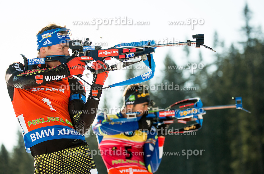 Simon Schempp (GER) and Martin Fourcade (FRA) compete during Men 12,5 km Pursuit at day 3 of IBU Biathlon World Cup 2015/16 Pokljuka, on December 19, 2015 in Rudno polje, Pokljuka, Slovenia. Photo by Vid Ponikvar / Sportida
