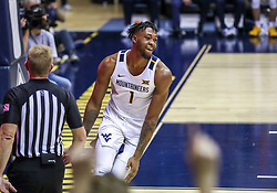 Dec 14, 2019; Morgantown, WV, USA; West Virginia Mountaineers forward Derek Culver (1) celebrates after a dunk during the second half against the Nicholls State Colonels at WVU Coliseum. Mandatory Credit: Ben Queen-USA TODAY Sports