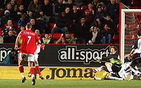 Photo. Daniel Hambury.<br /> Barclays Premiership.<br /> Charlton Athletic v Fulham. 20/12/2004<br /> Fulham's Edwin van der Sar lets a shot from Jerome Thomas (obscured) slip under him for the first goal