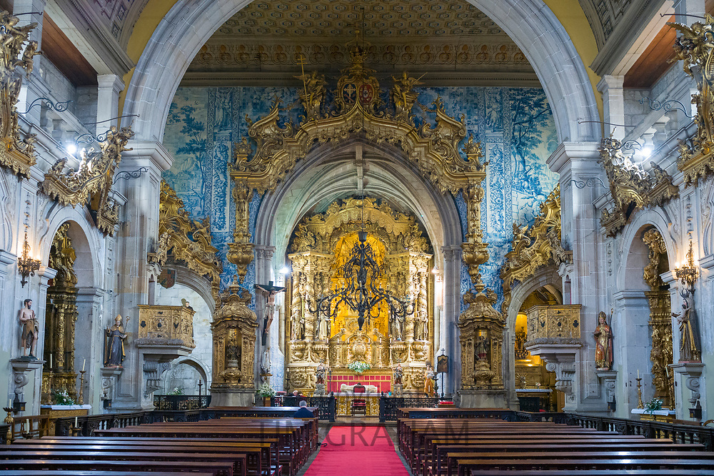 Church of Saint Francis with ornate gilt and traditional azulejos tiles above the altar in town of Guimaraes in Portugal