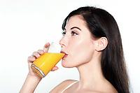 one beautiful young caucasian woman drinking orange juice on studio isolated white isolated background