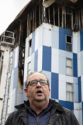 """© Licensed to London News Pictures. 16/11/2019. Bolton, UK. DAVID GREENHALGH of Bolton Council at a press conference at the site of the blaze . Firefighters work at the scene where a fire broke out overnight (15th/16th November 2019) at a block of flats known as """" The Cube """" , in Bolton Town Centre . At least two people are known to have been treated by paramedics at the scene of the six-story block , which is occupied by students of the University of Bolton . Photo credit: Joel Goodman/LNP"""