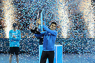Novak Djokovic lifts the trophy during the final of the ATP World Tour Finals between Roger Federer of Switzerland and Novak Djokovic at the O2 Arena, London, United Kingdom on 22 November 2015. Photo by Phil Duncan.