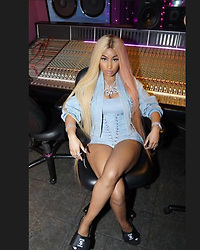 "Nicki Minaj releases a photo on Instagram with the following caption: ""Ummm I'm not gonna say any names but a dj from Queens had jokes on my cash money slides\ud83d\ude2d he said they gon roast me in the comments. \ud83d\ude29 I said btchs ain't got the heart! \ud83d\ude2dit was like 4 in the morning man, yikes. A btch can't take her heels off to record? Wow"". Photo Credit: Instagram *** No USA Distribution *** For Editorial Use Only *** Not to be Published in Books or Photo Books ***  Please note: Fees charged by the agency are for the agency's services only, and do not, nor are they intended to, convey to the user any ownership of Copyright or License in the material. The agency does not claim any ownership including but not limited to Copyright or License in the attached material. By publishing this material you expressly agree to indemnify and to hold the agency and its directors, shareholders and employees harmless from any loss, claims, damages, demands, expenses (including legal fees), or any causes of action or allegation against the agency arising out of or connected in any way with publication of the material."