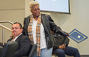 Wretha Thomas, right, comments to Leo Bobadilla during the Board of Education meeting, November 13, 2014.