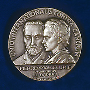 Marie (1867-1934) and Pierre (1859-1906) Curie. Obverse of medal commemorating the discovery of Radium in 1898.