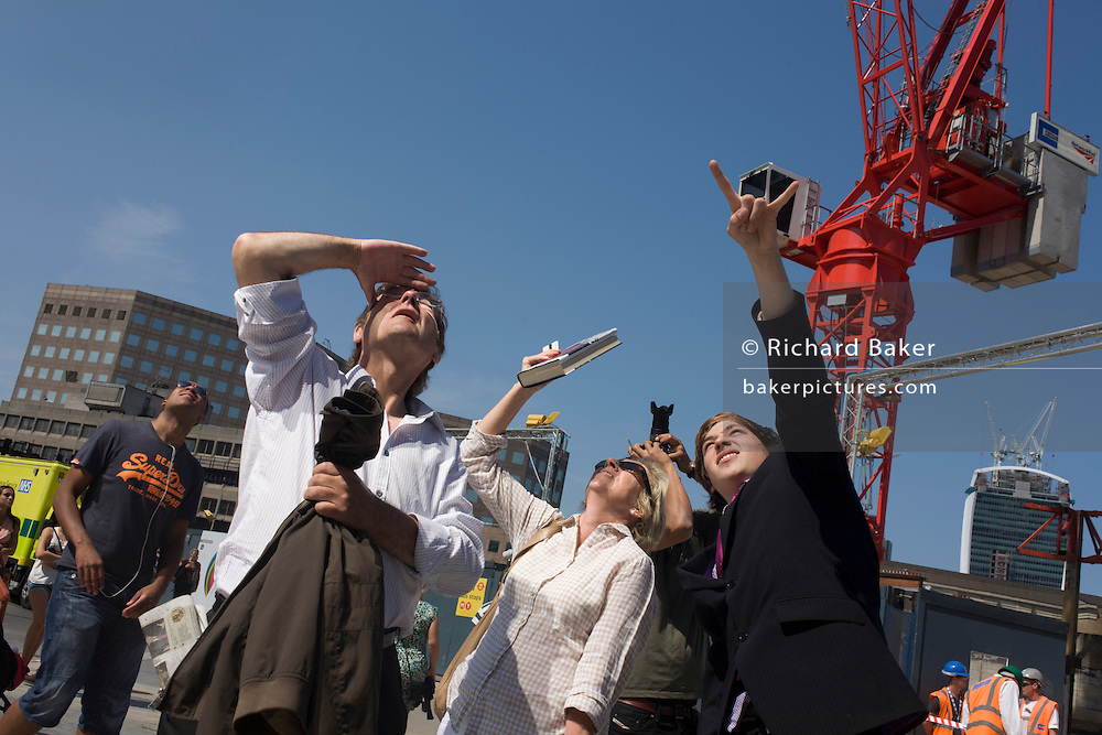 Londoners watch in awe as 6 Greenpeace climbers protesting against Shell's plans to drill for oil in the Arctic, scale the London skyscraper landmark known as The Shard in the capital. Completed in May 2012. The Shard is the tallest building in the European Union. The 46th-tallest building in the world, standing 310 m (1,017 ft) tall, it is also be the second-tallest free-standing structure in the UK. Several Qatari investors finded the construction of the tower via Islamic finance.