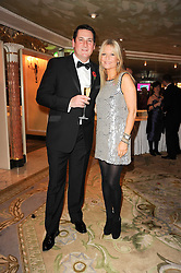 TONY HADLEY and GABY ROSLIN at the Fantasy Ball in aid if children's cancer charity CLIC Sargent held at The Dorchester, Park Lane, London on 11th November 2010.