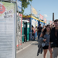 Participants stand next to the rules of participation at Sziget festival held in Budapest, Hungary on August 10, 2011. ATTILA VOLGYI