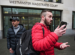 © Licensed to London News Pictures. 19/03/2019. London, UK. Yellow Vest protestor JAMES GODDARD (right) arrives at Westminster Magistrates Court in London where he is charged with harassing MP Anna Soubry and two public order offences against a police officer.  Photo credit: Ben Cawthra/LNP