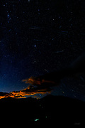 The headlamps of four mountaineering groups are seen ascending Mount Bierstadt in the predawn light under a star-filled Colorado sky streaked by the annual Perseid meteor shower.  Mount Bierstadt at 14,068 feet (4287 m) was first climbed in 1863 and is the 38th tallest peak in Colorado and the 44th tallest in the continental United States.  Groups typically begin their ascent in the early morning so as to complete the 6.9 mile trail and be off the mountain before the danger of afternoon thunderstorms common in this area.<br /> <br /> Best observed in the Northern Hemisphere and down to the mid-southern latitudes, the annual Perseid meteor shower occurs each summer when the earth passes through a stream of dust from comet Swift-Tuttle.  Comet Swift-Tuttle is the largest object known to repeatedly pass by earth and has a nucleus 16 miles (26 kilometers) wide. It last passed by earth during its orbit around the sun in 1992 and will next do so in 2126.<br /> <br /> This image is a composite of 10 photographs over a total of 171 seconds between 3:21am and 3:30am which captured a total of 34 meteors.