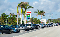 September 12, 2017 - West Palm Beach, Florida, U.S. - Gas lines are back Tuesday morning, as cars back up on Belvedere Road at the Wawa. With many gas stations out of power, only a very few running on generators are able to provide fuel.  (Credit Image: © Lannis Waters/The Palm Beach Post via ZUMA Wire)