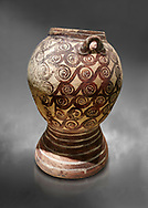 Minoan Theran style strainer jar decorated with spirals on a dark background, Akrotiri, Thira (Santorini) National Archaeological Museum Athens. 17th-16th cent BC.<br /> <br /> This style of strainer jar is characteristic of Theran Minoan pottery also found on Minoan Crete. A strainer incorporated into the jar probably allowed it to be used in the manufacture of aramatic oils or as an incense burner. .<br /> <br /> If you prefer to buy from our ALAMY PHOTO LIBRARY  Collection visit : https://www.alamy.com/portfolio/paul-williams-funkystock/minoan-art-artefacts.html . Type -   Athens    - into the LOWER SEARCH WITHIN GALLERY box. Refine search by adding background colour, place, museum etc<br /> <br /> Visit our MINOAN ART PHOTO COLLECTIONS for more photos to download  as wall art prints https://funkystock.photoshelter.com/gallery-collection/Ancient-Minoans-Art-Artefacts-Antiquities-Historic-Places-Pictures-Images-of/C0000ricT2SU_M9w