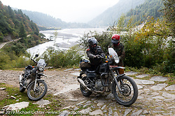 Danita Gayle gets help from Gary Thomas on Motorcycle Sherpa's Ride to the Heavens motorcycle adventure in the Himalayas of Nepal. On the fourth day of riding, we went from Kalopani to Muktinath. Thursday, November 7, 2019. Photography ©2019 Michael Lichter.