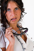 Hispanic businesswoman posing with sunglasses very sensual