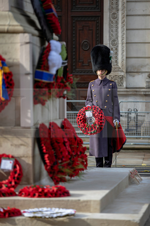 © Licensed to London News Pictures. 11/11/2020. London, UK. Wreaths are laid during a small Armistice Day ceremony at the Cenotaph. Photo credit: Rob Pinney/LNP