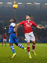 Aaron McLean of Peterborough United and Derrick Williams of Bristol City compete in the air - Photo mandatory by-line: Rogan Thomson/JMP - 07966 386802 - 28/11/2014 - SPORT - FOOTBALL - Peterborough, England - ABAX Stadium - Peterborough United v Bristol City - Sky Bet League 1.