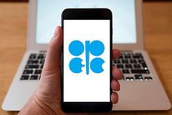 Using iPhone smartphone to display logo of OPEC , Organization of the Petroleum Exporting Countries