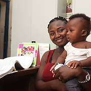 INDIVIDUAL(S) PHOTOGRAPHED: Abusede Babazoza (left) and unknown (right). LOCATION: Epko Abasi Clinic, Calabar, Cross River, Nigeria. CAPTION: Abusede Babazoza and her baby wait for their medication in the pharmacy section of the Epko Abasi Clinic.