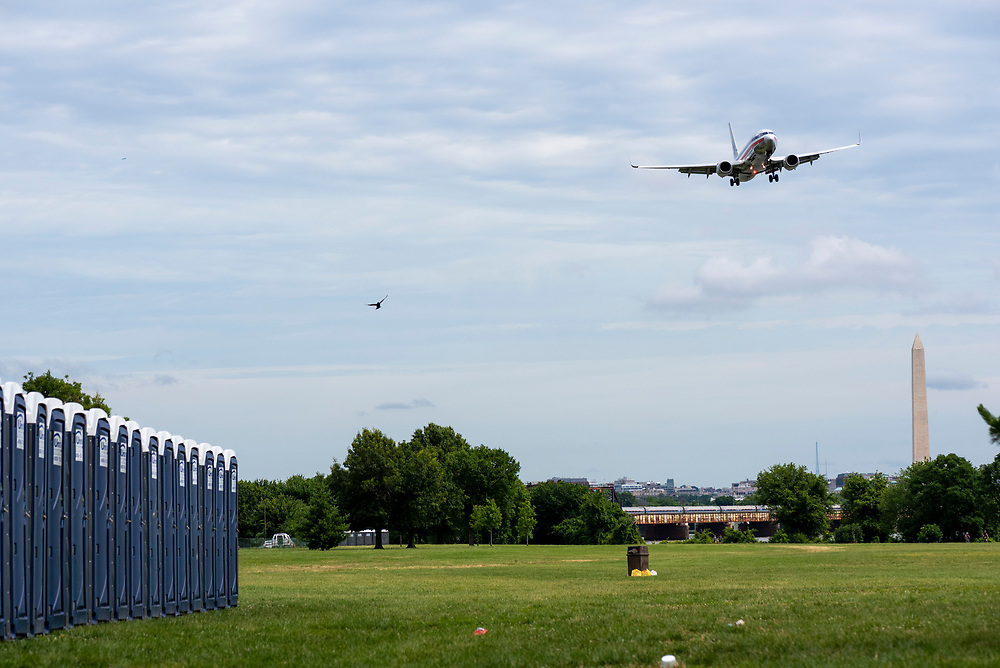 An American Airlines plane banks as it lines up for landing at Ronald Reagan Washington National Airport in Arlington, Virginia. Photo taken at Gravelly Point.<br /> <br /> (July 3, 2016)
