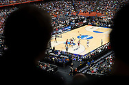27 MAR 2015: Fans look on as Quentin Snider (2) of the University of Louisville takes on the North Carolina State University during the 2015 NCAA Men's Basketball Tournament held at the Carrier Dome in Syracuse, NY. Louisville defeated North Carolina State 75-65. Brett Wilhelm/NCAA Photos