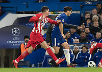 Football - 2017 / 2018 UEFA Champions League - Group C: Chelsea vs. Atletico Madrid<br /> <br /> Alvaro Morata (Chelsea FC)  gets a shove in the back from an Atletico player as he continues to be fouled at Stamford Bridge.<br /> <br /> COLORSPORT/DANIEL BEARHAM