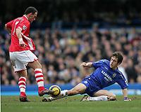 Photo: Lee Earle.<br /> Chelsea v Charlton Athletic. The Barclays Premiership. 22/01/2006. Chelsea's Joe Cole (R) slides in on Radostin Kishishev.