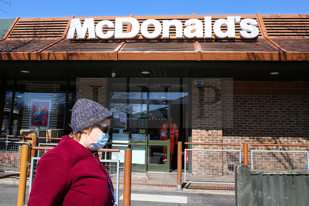 © Licensed to London News Pictures. 23/03/2020. London, UK. A woman wearing a face mask walks past McDonald's in Haringey north London. McDonald's restaurants across the UK are to close from 7pm tonight as the spread of the coronavirus continues in the country. Photo credit: Dinendra Haria/LNP