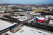 Nederland, Utrecht, Lage Weide, 31-01-2010; bedieningsgebouw van de landtunnel van de A2  in de voorgrond, de rode doos is muziekcentrum Vredenburg Leidsche Rijn. Op het tweede plan spoorbrug en verkeersbrug over het Amsterdam-Rijnkanaal, Hogeweidebrug, met daarachter Merwede elektriciteitscentrale van Nuon centrale. Links de tweede elektriciteitscentrale (Lage Weide)..In the foreground control building of the landtunnel of the A2, the red box is concert hall  Vredenburg Leidsche Rijn. Rail bridge and road bridge over the Amsterdam-Rhine Canal, and  Nuon Merwede power plant. Left second  power plant (Lage Weide)..luchtfoto (toeslag), aerial photo (additional fee required).foto/photo Siebe Swart