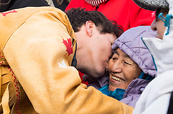 Prime Minister Justin Trudeau greets a elder with a kiss following a ceremony near Chilko Lake, B.C.,Friday, Nov. 2, 2018. The Prime Minister was in the area to apologize to the Tsilhqot'in community for the hangings of six chiefs during the so-called Chilcotin War over 150 years ago. Photo by The Canadian Press /Jonathan Hayward/ABACAPRESS.COM