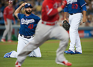 Dodgers' pitcher Chris Hatcher throws out the Angels' Shane Robinson on a sacrifice bunt scoring Johnny Giavotella in the seventh inning during their Freeway Series game Friday night at Dodger Stadium.<br /> <br /> <br /> ///ADDITIONAL INFO:   <br /> <br /> freeway.0402.kjs  ---  Photo by KEVIN SULLIVAN / Orange County Register  --  4/1/16<br /> <br /> The Los Angeles Angels take on the Los Angeles Dodgers at Dodger Stadium during the Freeway Series Friday.<br /> <br /> <br />  4/1/16