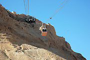Israel, Masada, the ascent to Metzada as seen from the cable car Metzada is the site of ancient palaces and fortifications in Israel on top of an isolated rock cliff on the eastern edge of the Judean desert overlooking the Dead Sea. where Jewish zealot insurgents held out for three years against the Romans after the fall of Jerusalem in 70C.E. and then committed mass suicide to avoid capture. Metzada has remained a symbol of Jewish heroism.