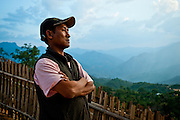 David Suirungbo, 40, looks out over the valley below Layshee. Suirungbo was born to Christian parents in Somra village, several ridges closer to the Indian border. He now runs a shop with his wife, but he worked for many years as an itinerant peddler in the Naga Hills, evading rogue Burmese soldiers, ethnic insurgents, and tigers.