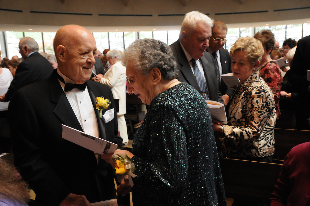 Nearly 350 couples celebrating their 50th wedding anniversary in 2010 attend a mass in their honor at St. John Brebeuf Parish in Niles. The Golden Jubiliarian couples are lead in a renewal of their wedding vows by the Francis Cardinal George.