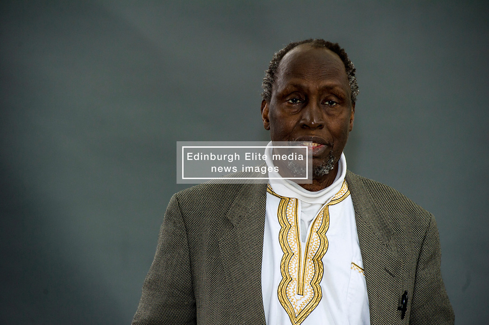 """Pictured: Ngũgĩ wa Thiong'o<br /> <br /> Ngũgĩ wa Thiong'o (Gikuyu pronunciation: [ᵑɡoɣe wá ðiɔŋɔ]; born 5 January 1938)[1] is a Kenyan writer, formerly working in English and now working in Gikuyu. His work includes novels, plays, short stories, and essays, ranging from literary and social criticism to children's literature. He is the founder and editor of the Gikuyu-language journal Mũtĩiri.<br /> <br /> In 1977, Ngũgĩ embarked upon a novel form of theatre in his native Kenya that sought to liberate the theatrical process from what he held to be """"the general bourgeois education system"""", by encouraging spontaneity and audience participation in the performances.[2] His project sought to """"demystify"""" the theatrical process, and to avoid the """"process of alienation [that] produces a gallery of active stars and an undifferentiated mass of grateful admirers"""" which, according to Ngũgĩ, encourages passivity in """"ordinary people"""". Although Ngaahika Ndeenda was a commercial success, it was shut down by the authoritarian Kenyan regime six weeks after its opening.<br /> <br /> Ngũgĩ was subsequently imprisoned for over a year. Adopted as an Amnesty International prisoner of conscience, the artist was released from prison, and fled Kenya. In the United States, he taught at Yale University for some years, and has since also taught at New York University, with a dual professorship in Comparative Literature and Performance Studies, and at the University of California, Irvine. Ngũgĩ has frequently been regarded as a likely candidate for the Nobel Prize in Literature. His son is the author Mũkoma wa Ngũgĩ.<br /> <br /> Ger Harley   EEm 11 August 2018"""