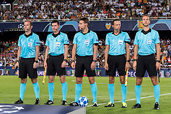 the referee team with referee Felix Brych (M) during the UEFA Champions League group H match between Valencia FC and Juventus FC at Estadi de Mestalla on September 19, 2018 in Valencia, Spain