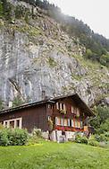 Chalet beneath cliffs in Lauterbrunnen Valley, Switzerland
