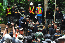 July 6, 2018 - Chiang Rai, Thailand - Rescuers carry a giant water pump into a cave in Chiang Rai. With more rain coming, Thai rescuers are racing against time to pump out water from a flooded cave before they can rescue 12 boys and their soccer coach with minimum risk, officials said Thursday. (Credit Image: © Rachen Sageamsak/Xinhua via ZUMA Wire)