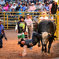 070613       Adron Gardner/Independent<br /> <br /> Aaron Burbank, 75 points braces for impact after scoring a 75-point ride during Native Extreme Bull Riding at the Navajo Nation Fairgrounds in Window Rock Saturday.