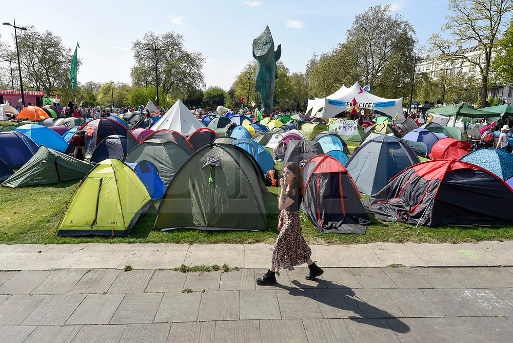 """© Licensed to London News Pictures. 22/04/2019. LONDON, UK. Activists' tents at Marble Arch during """"London: International Rebellion"""", on day eight of a protest organised by Extinction Rebellion.  Protesters are demanding that governments take action against climate change.  After police issued section 14 orders at the other protest sites of Oxford Circus, Waterloo Bridge and Parliament Square resulting in over 900 arrests, protesters have convened at the designated site of Marble Arch so that the protest can continue.  Photo credit: Stephen Chung/LNP"""