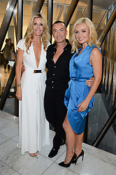 Left to right, MELISSA ODABASH, JULIEN MACDONALD and KATHERINE JENKINS at the launch of the Odabash Macdonald Resort 2014 swimwear collection at ME Hotel, London on 25th June 2013.