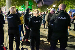 """© Licensed to London News Pictures; 26/09/2020; Bristol, UK. Police stop a band busking and disperse a crowd of people who had gathered to listen in the city centre after the 10pm curfew early closing of pubs and bars. The band said they had asked the crowd to socially distance. This is the first weekend of the 10pm early closing curfew for pubs, bars and restaurants across the UK, imposed by the government to try and halt a second wave of the covid-19 coronavirus pandemic. Gathering in groups of more than six people is also banned and there are penalties of £200 on the first offence. From Monday 14 September it was illegal to meet up socially in groups of more than six people, known as the """"Rule of Six"""", in order to try and contain the spread of the covid-19 coronavirus pandemic. Photo credit: Simon Chapman/LNP."""
