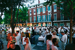 02 August 2014. New Orleans, Louisiana.<br /> Crowds gather on Julia Street and in galleries in the arts district for the Whitney White Linen night. <br /> Photo; Charlie Varley/varleypix.com