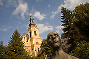The Orthodox Cathedral and a statue of Mesa Selimovic, Sarajevo, Bosnia. Mesa Selimovic (1910-1982) was a Yugoslav writer born in Bosnia.