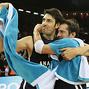 Anadolu Efes's Kerem Gonlum (L) and Kerem Tunceri (R) celebrate victory during their Turkish Airlines Euroleague Basketball Top 16 Game 7 match Anadolu Efes between Real Madrid at the Abdi ipekci Arena in Istanbul, Turkey, Thursday, February 14, 2013. Photo by TURKPIX