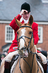 © Licensed to London News Pictures.26/12/12014. Market Bosworth, Leicestershire, UK. The annual Boxing Day Hunt Meeting took place in the market square earlier today. Pictured, the hunt master arrives in the square. Photo credit : Dave Warren/LNP